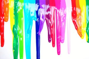 colours of different paint types dripping on a screen