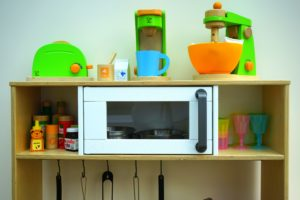 a convection microwave oven in the shelf