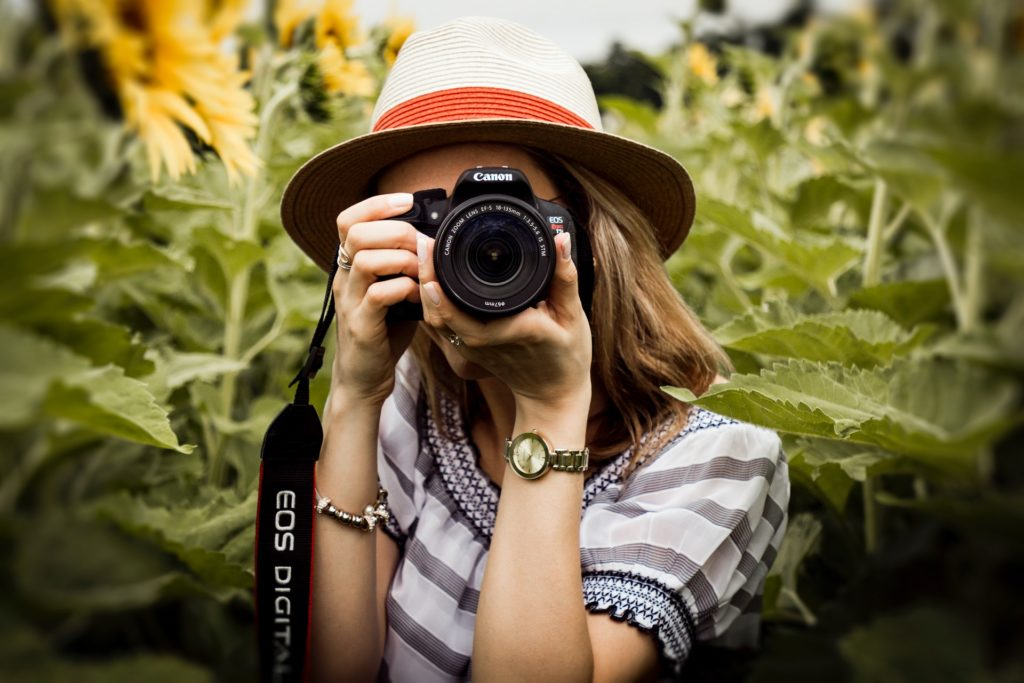 a best buy camera from Canon DSLR handled by a young girl for shooting
